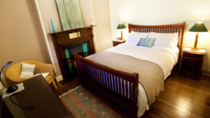 The Grevillea room features a queen sized timber bed with exquisite bed linen.
