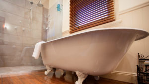 The original claw-foot bath with large shower recess